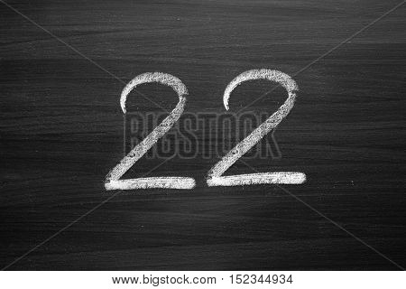 number twenty two enumeration written with a chalk on the blackboard