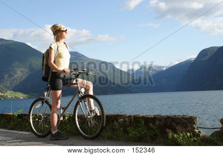 Sporty Woman On A Bike Trip In The Mountains
