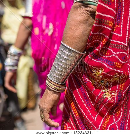 Rajasthani womens hands with traditional silver bracelets close-up