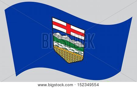 Albertan provincial official flag symbol. Canada banner and background. Canadian AB patriotic element. Flag of the Canadian province of Alberta waving on gray background vector