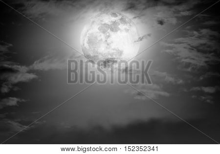 Nighttime Sky With Clouds And Bright Full Moon.  Black And White Tone.