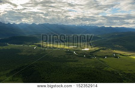 Evening rays on Kronotsky Nature Reserve in Kamchatka Peninsula. View from helicopter.
