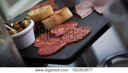 lunch platter of bread ham salami olives