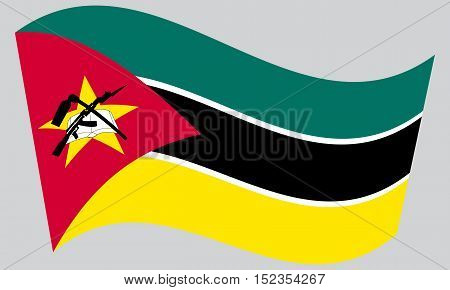 Mozambican national official flag. African patriotic symbol banner element background. Correct colors. Flag of Mozambique waving on gray background vector