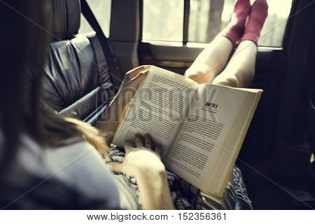 Girl Reading Book Road Trip Concept