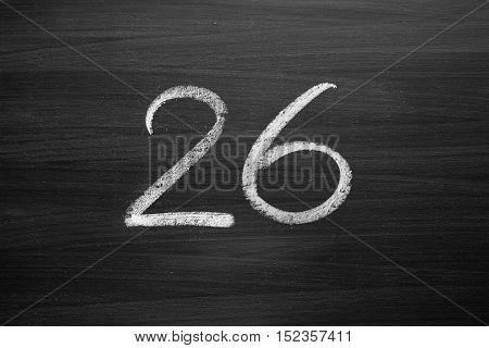 number twenty six enumeration written with a chalk on the blackboard