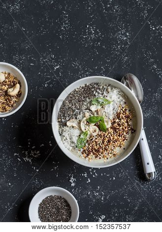 Super food smoothie bowl on a dark background. Healthy Breakfast