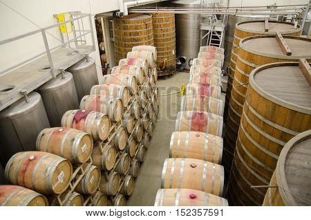 Wine Barrels At Vineyard In California