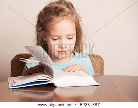 Girl doing homework. Child education