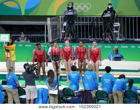 RIO DE JANEIRO, BRAZIL - AUGUST 4, 2016: Team United States during an artistic gymnastics training session for Rio 2016 Olympics at the Rio Olympic Arena