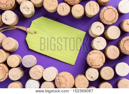 Many cork stoppers with green label on purple background