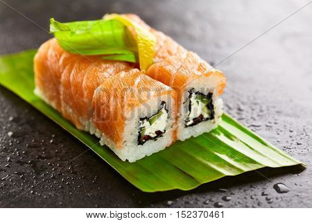 Freshness Roll with Cream Cheese, Cucumber and Salmon Roe inside. Salmon topped. Served on Banana Leaf
