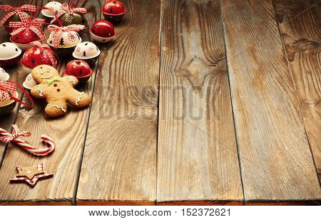 Christmas homemade gingerbread man cookie and decoration on wooden background