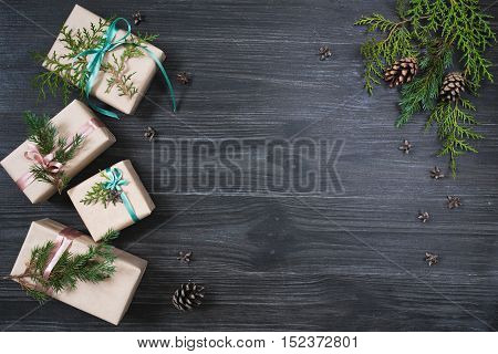 Christmas background with four gift boxes and decorations