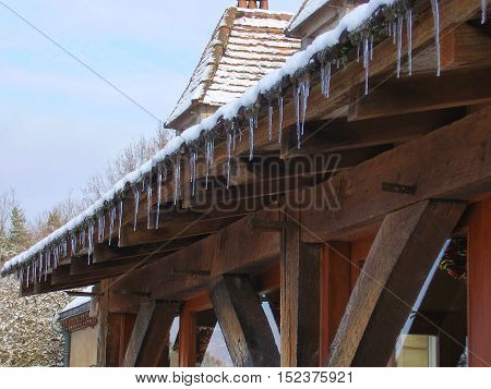 Icicles hanging from the roof of a conservatory
