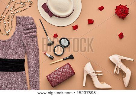 Fashion woman Clothes Accessories Set. Essentials Fashion Cosmetic Makeup. Stylish Lady Dress, Handbag, Glamor Heels, Rose. Trendy fashion Design. Top view. Fall Fashion. Vintage. Cosmetic Overhead