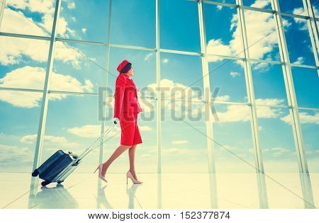 Young stewardess at the airport