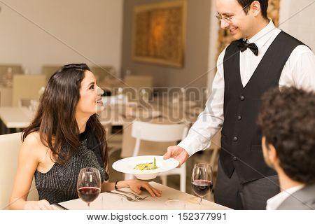 Waiter serving the dinner
