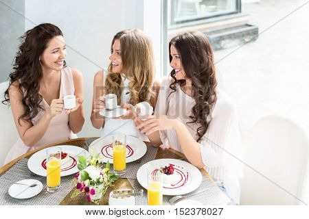 Smiling young women in cafe