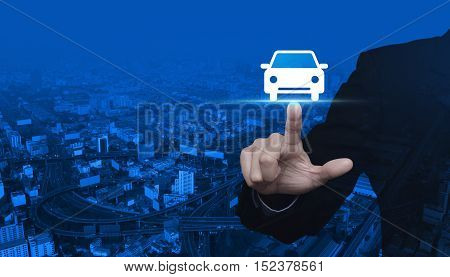 Businessman pressing car front view flat icon over city tower and street blue tone background Business service car concept