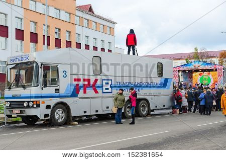 SENNO BELARUS - OCTOBER 8 2016: Film crew of television and radio company