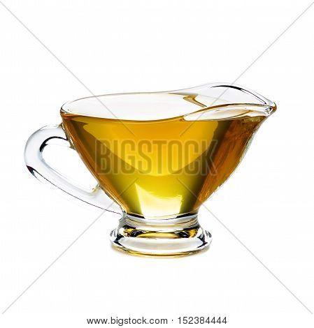 Delicious Fresh Olive Oil in Glass Gravy Boat isolated on White background