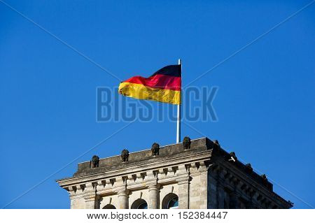 German flag in front of the Reichstag - German Parliament Bundestag