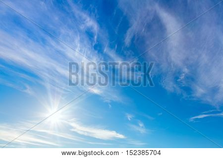 Happy Sunny background of blue sky with real sun and light clouds, good day, warm weather. Big size