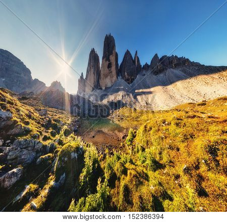 Great view of the sunny Lago Rienza - Ursprung in National Park Tre Cime di Lavaredo. Dolomites, South Tyrol. Location Auronzo, Italy, Europe. Picturesque and gorgeous morning scene. Beauty world.