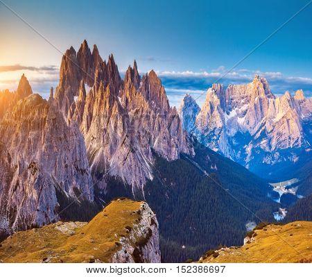Great view of the Cadini di Misurina range and Sorapis group in National Park Tre Cime di Lavaredo. Dolomites, South Tyrol. Location Auronzo, Italy, Europe. Dramatic light morning. Beauty world.