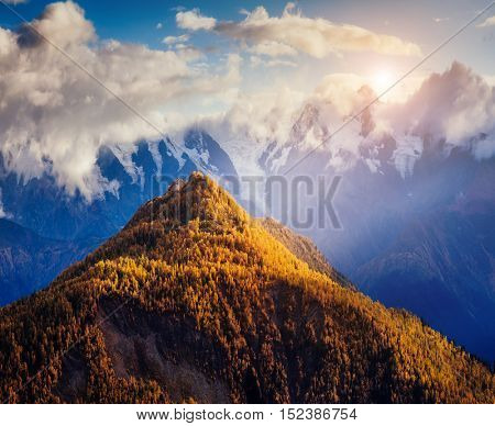 Nice views of the foot of Mt. Ushba illuminated by sunlight. Dramatic and picturesque morning scene. Location famous place Mestia, Upper Svaneti, Georgia, Europe. High Caucasus ridge. Beauty world.