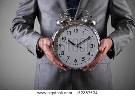 Businessman with clock in business concept