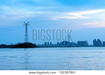 High-voltage tower in the sea the evening landscape.