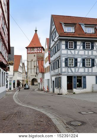 Waiblingen, Germany - April 16, 2016: The walking street of Waiblingen with old half-timbered houses and tower in perspective. Baden-Wurttemberg, Germany.