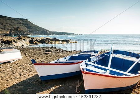 painted fishing boats on Canary Island shore in bay, Lanzarote, Spain