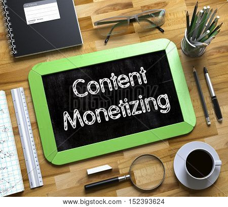 Content Monetizing Handwritten on Green Chalkboard. Top View Composition with Small Chalkboard on Working Table with Office Supplies Around. Content Monetizing on Small Chalkboard. 3d Rendering.