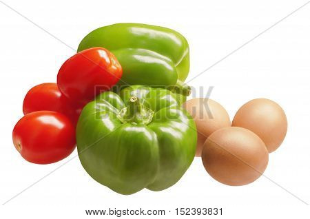 Two sweet bell peppers with tomatoes and eggs. Ingredients for cooking