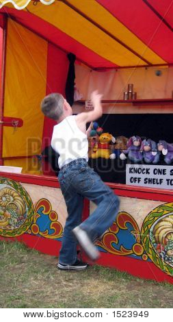 Boy Playing Tin Can Alley Game.Leisure.Motion.Movement