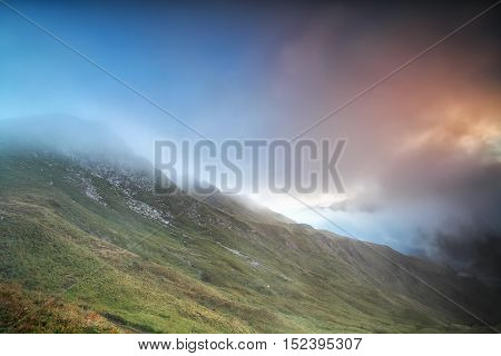 mountains covered with sunrise fog Alps Austria