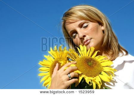 Beautiful Sunflower Woman And A Blue Sky