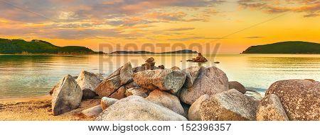 Amazing landscape at sunset. Stones on the foreground. Panorama