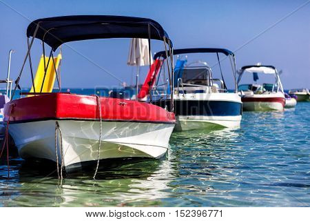 Motor boats at the pier in the sea