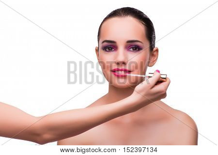 Woman applying lipstick isolated on white
