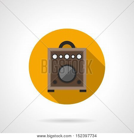 Brown wooden amplifier box for guitar. Professional equipment for concerts and music entertainment. Round yellow flat design vector icon.