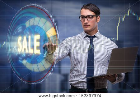 Businesswoman with laptop in sale concept