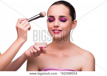 Woman getting make-up isolated on white