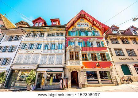 Zug, Switzerland - June 28, 2016: Colorful buildings on the center of Zug town near Zurich city in Switzerland