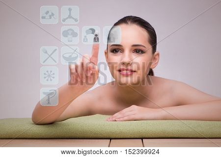 Woman in spa pressing buttons