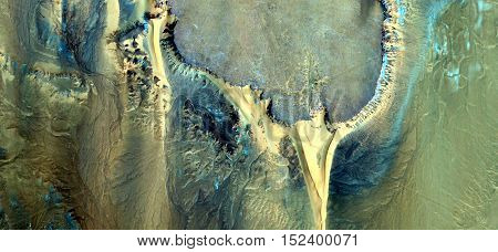 Abstract photography of landscapes of deserts of Africa from the air, allegory Stone Christ,