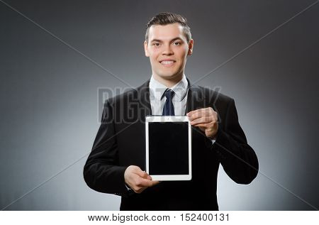 Businessman using his tablet computer in business concept